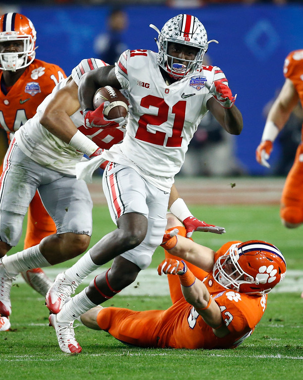. Ohio State wide receiver Parris Campbell (21) escapes the reach of Clemson linebacker Chad Smith (43) during the first half of the Fiesta Bowl NCAA college football game, Saturday, Dec. 31, 2016, in Glendale, Ariz. (AP Photo/Ross D. Franklin)