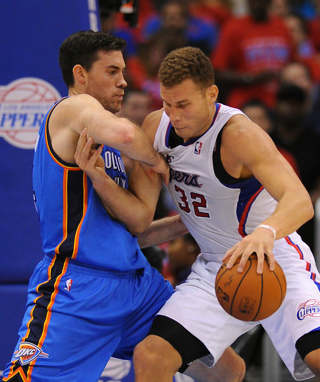 . The Clippers\' Blake Griffin tries to back down the Thunder\'s Nick Collison, Thursday, May 15, 2014, at Staples Center. (Photo by Michael Owen Baker/Los Angeles Daily News)