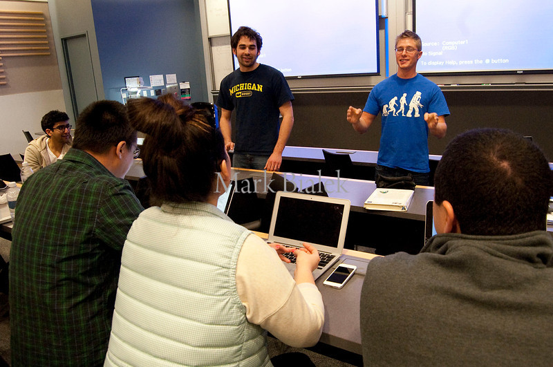 University of Michigan students Evan Noon, left, and Kyle Smith present their collaborative real-time typing tool app to the judges from imo.im toward the end of a 22-hour 'Hackathon' on the University of Michigan's North Campus on Jan 19, 2013.  Silicon Valley startup imo.im is looking for talent for its growing online business.  http://blog.imo.im/2013/01/imo-spends-weekend-in-michigan-for.html