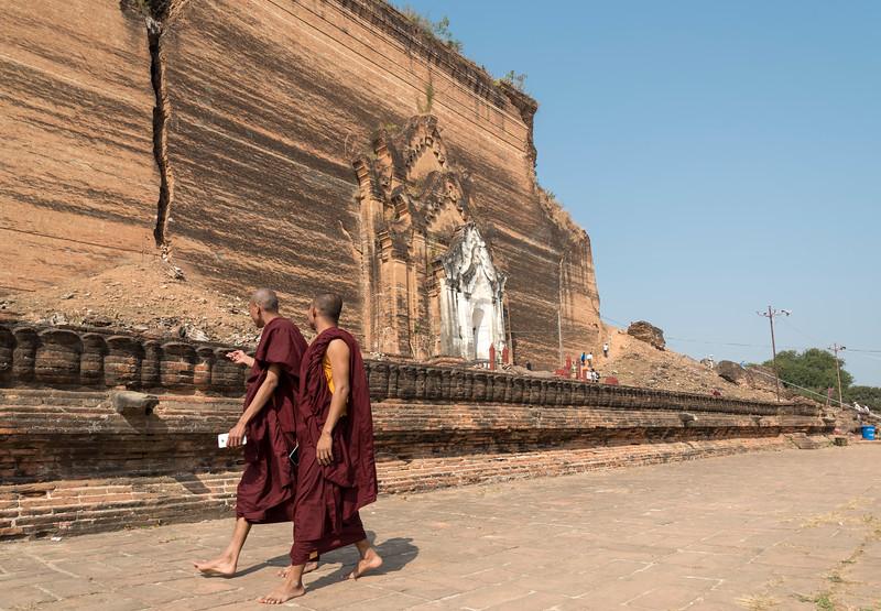 Two Buddhist monks in front of Mingun Pagoda (Pahtodawgyi), Burma (Myanmar)