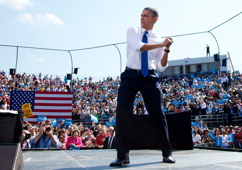 . President Barack Obama swings with an imaginary bat as he arrives on stage to speak at a campaign event at  G. Richard Pfitzner Stadium, Friday, Sept. 21, 2012, in Woodbridge, Va. (AP Photo/Carolyn Kaster)