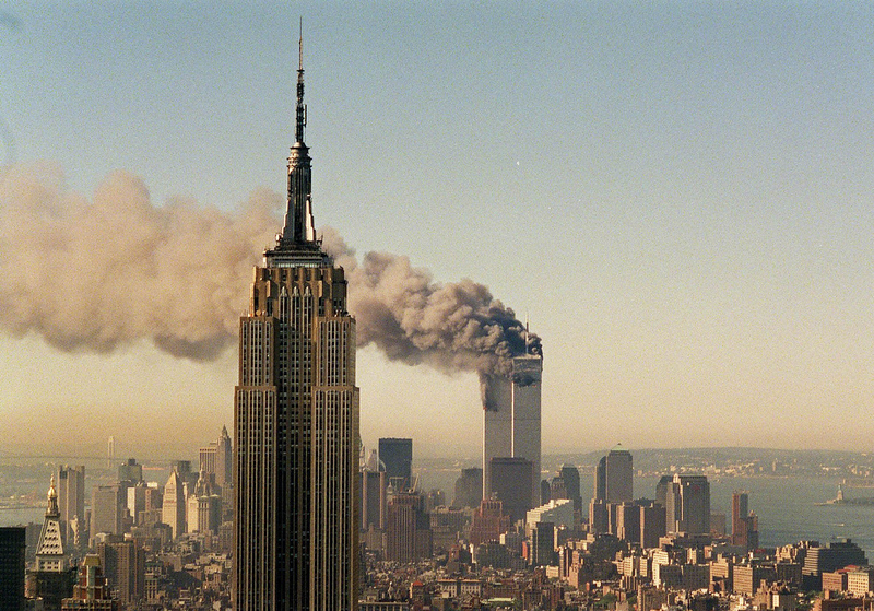 . This Sept. 11, 2001 file photo shows the twin towers of the World Trade Center burning behind the Empire State Building in New York.   (AP Photo/Marty Lederhandler, FILE)