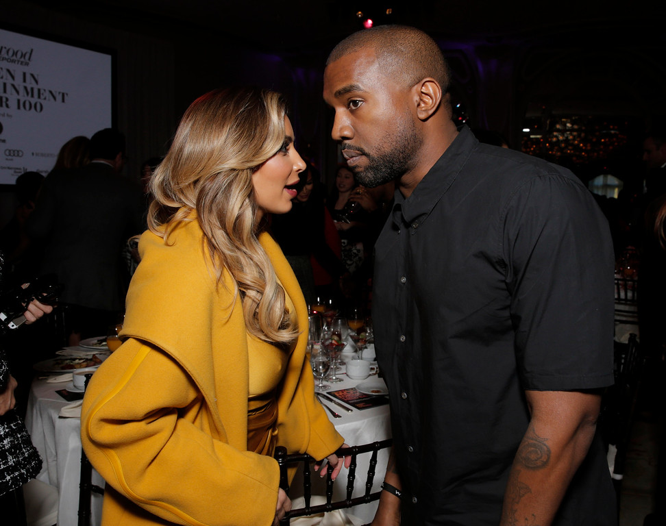 . Kim Kardashian, left, and Kanye West attend THR\'s celebration of power 100 women in entertainment breakfast on Wednesday, Dec. 11, 2013 in Beverly Hills, Calif.  (Photo by Todd Williamson/Invision for The Hollywood Reporter/AP Images)