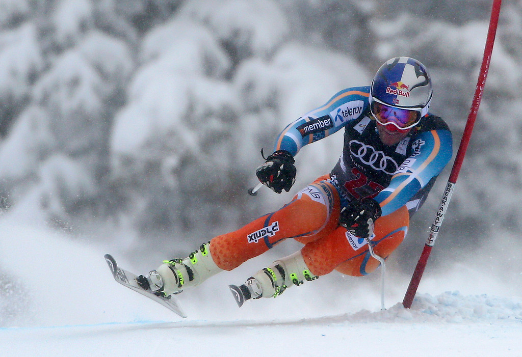 . Norway\'s Aksel Lund Svindal clips a gate during the men\'s World Cup downhill skiing event, Friday, Dec. 6, 2013, in Beaver Creek, Colo. Svindal logged the fastest time to take first place in the race. (AP Photo/Alessandro Trovati)