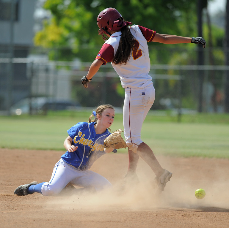 . 05-16-2013-( Daily Breeze Staff Photo by Sean Hiller) Wilson vs. El Toro in the opening round of the CIF-SS D2 playoffs Thursday at Joe Rodgers Field in Long Beach. Wilson\'s Alleah Laxamana is safe at second base despite efforts by El Toro\'s Alyssa James.