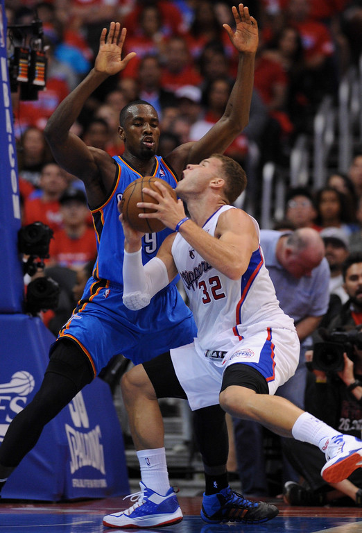 . Clippers\' Blake Griffin collides with the Thunder\'s Serge Ibaka in the third quarter causing Griffin a bloody nose. (Photo by Michael Owen Baker/Los Angeles Daily News)