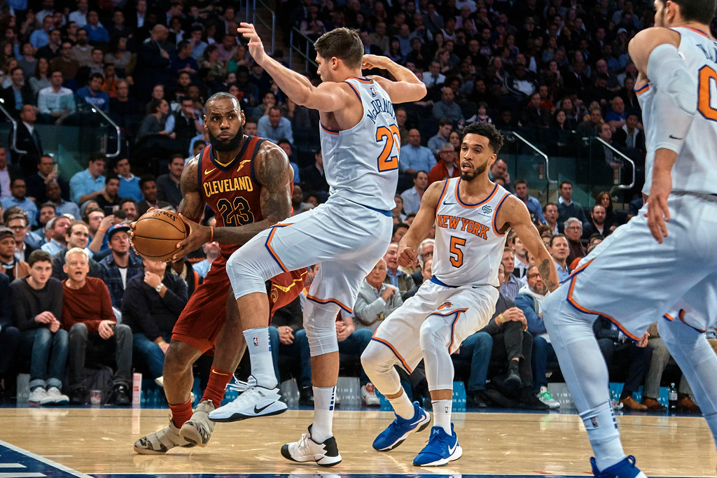 . Cleveland Cavaliers\' LeBron James, left, dribbles between New York Knicks players during the first half of a NBA basketball game at Madison Square Garden in New York, Monday, Nov. 13, 2017. (AP Photo/Andres Kudacki)