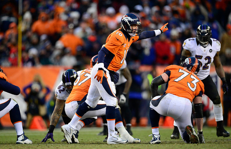 . Denver Broncos quarterback Peyton Manning (18) calls a play at the line in the third quarter. The Denver Broncos vs Baltimore Ravens AFC Divisional playoff game at Sports Authority Field Saturday January 12, 2013. (Photo by AAron  Ontiveroz,/The Denver Post)