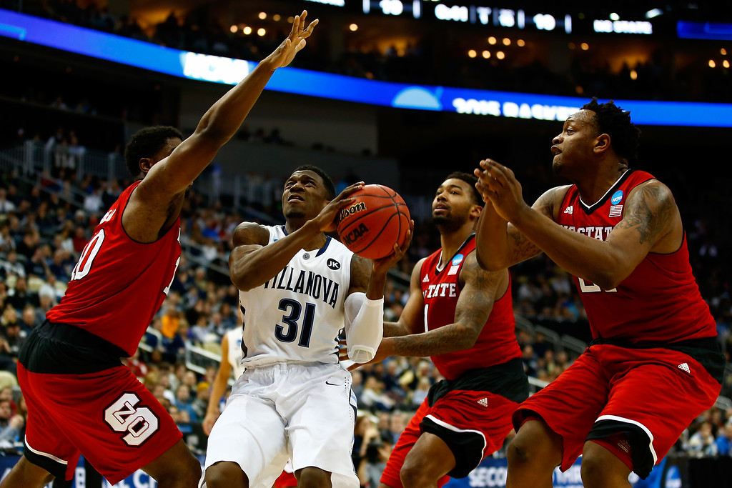 . Dylan Ennis #31 of the Villanova Wildcats drives to the basket in the first half against the North Carolina State Wolfpack during the third round of the 2015 NCAA Men\'s Basketball Tournament at Consol Energy Center on March 21, 2015 in Pittsburgh, Pennsylvania.  (Photo by Jared Wickerham/Getty Images)