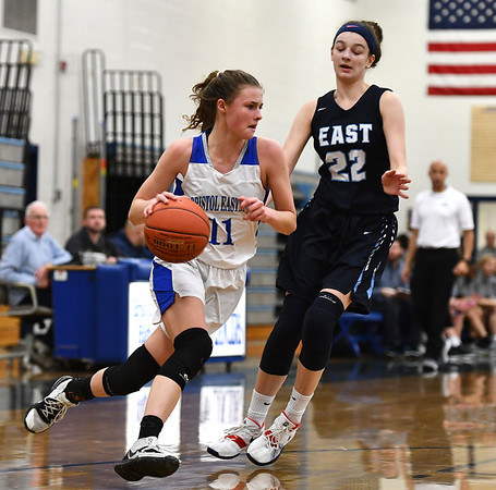 2/18/2020 Mike Orazzi | StaffrBristol Eastern's Ciara Collins (11) and East Catholic's Emily Jeamel (22) during a 57-52 Eastern overtime win in Bristol Tuesday afternoon.