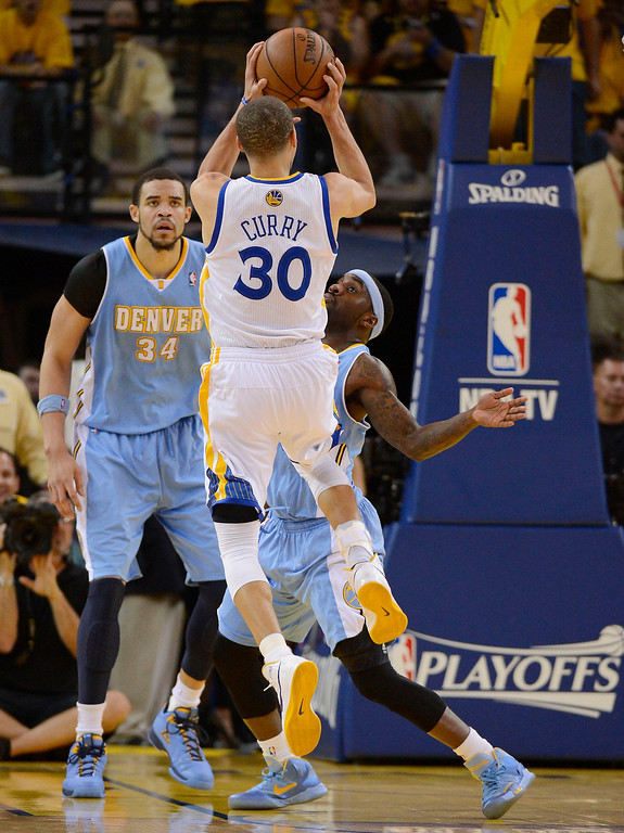. ,g30 takes a shot over Ty Lawson (3) of the Denver Nuggets during the second quarter in Game 6 of the first round NBA Playoffs May 2, 2013 at Oracle Arena. Lawson was called for the foul on the play. (Photo By John Leyba/The Denver Post)
