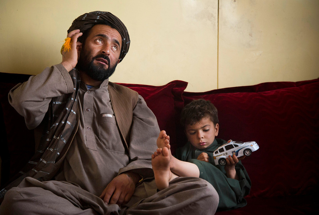 . Mohammed Wazir sits with his only surviving son, Habib Shahin, 3, in Kandahar, Afghanistan on Monday, April 22, 2013 as he talks about the events of March 11, 2012 when a U.S. soldier burst into his family\'s home. Wazir returned to his home that morning to find 11 members of his family dead, their bodies partially burned. The youngest among the dead was his 1-year-old daughter Palawan Shah. U.S. Army Staff Sgt. Robert Bales of Lake Tapps, Washington, is accused of the killings. Bales has not entered a plea, but his lawyers have not disputed his involvement. The Army is seeking the death penalty. (AP Photo/Anja Niedringhaus)