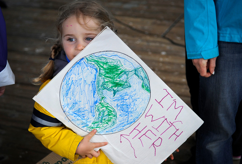 Simone Hinman, 4, holds a sign that she made with her parents for the March for Science protest in downtown Coos Bay in part of a global day of protests in celebration of Earth Day on April 21, 2017.