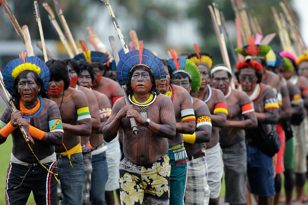 . Brazilian Indians representing various tribes takes part in the first day of the National Indigenous Mobilization protest in Brasilia, Brazil, Tuesday, Oct. 1, 2013. The protest is against a proposed constitutional amendment known as PEC 215, which amends the rules for demarcation of indigenous lands. (AP Photo/Eraldo Peres)