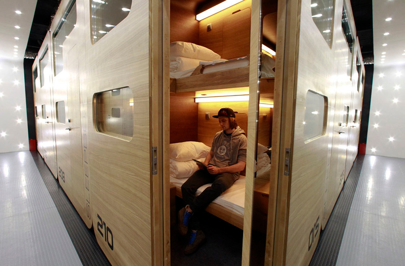 . A guest sits in his individual sleeping quarters in Moscow\'s first micro hostel February 3, 2013. The hostel offers accommodation for over 100 people in self-contained prefabricated sleeping cells called sleepboxes, according to the hostel administration. REUTERS/Sergei Karpukhin