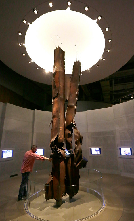 . In this Friday, Sept. 11, 2015 file photo, Landon Cole reaches out to touch steel beams from the World Trade Center on display at the The George W. Bush Presidential Library and Museum in Dallas. �They are the relics of the destruction and they have the same power in the same way as medieval relics that have the power of the saints,� said Harriet Senie, a professor of art history at the City University of New York and author of �Memorials to Shattered Myths: Vietnam to 9/11.� (AP Photo/LM Otero)