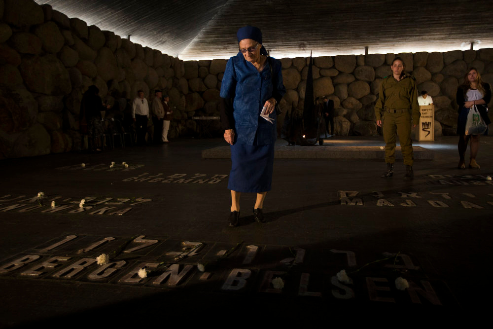 "Description of . A woman stands in the Hall of Remembrance at Yad Vashem in Jerusalem, during a ceremony entitled ""Unto Every Person There is a Name,\"" marking Israel\'s annual day of Holocaust remembrance, April 8, 2013. Israel on Monday commemorates the six million Jews killed by the Nazis in the Holocaust during World War Two. REUTERS/Ronen Zvulun"