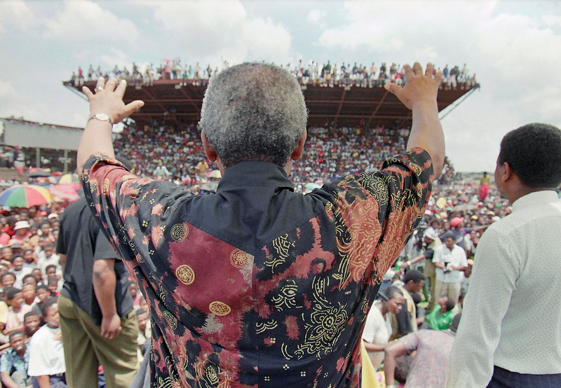 . President of the African National Congress Nelson Mandela reaches out to the crowd greeting him on Monday, Jan. 31, 1994 in Ikageng Stadium, a township just outside the western Transvaal city Potchefstroom.  Mandela has been enthusiastically welcomed by large crowds throughout western Transvaal on his two-day campaign swing for the April 27 all-race general elections. (AP Photo/David Brauchli)