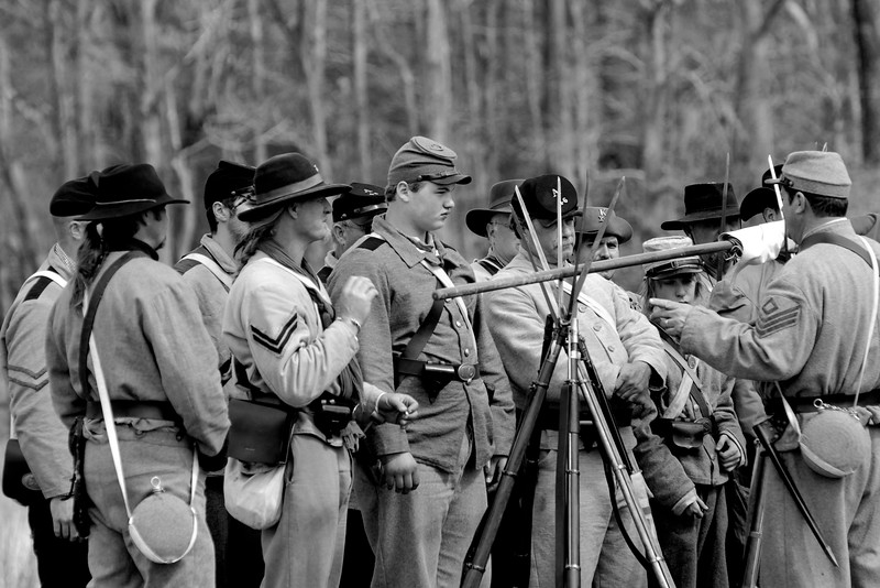 Members of the 20th North Carolina Infantry stack arms and rest on the battlefield before the reenactment. The Skirmish at Gamble's Hotel happened on March 5, 1885 when 500 federal soldiers, under the command of Reuben Williams of the 12th Indiana Infantry, marched into Florence to destroy the railroad depot but were met by Confederate soldiers backed up with 400 militia. The reenactment, held by the 23rd South Carolina Infantry, was held at the Rankin Plantation in Florence, South Carolina on Saturday, March 5, 2011. Photo Copyright 2011 Jason Barnette