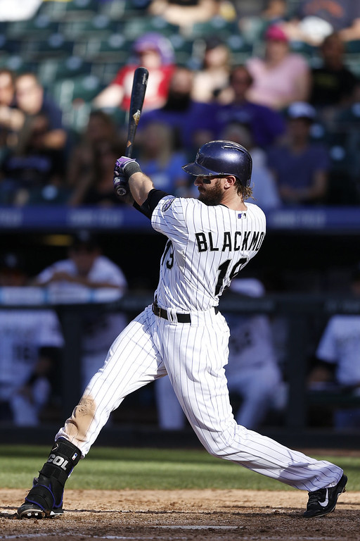 . Charlie Blackmon #19 of the Colorado Rockies drives in a run with a triple in the eighth inning of the game against the San Diego Padres at Coors Field on September 7, 2014 in Denver, Colorado. The Rockies won 6-0. (Photo by Joe Robbins/Getty Images)