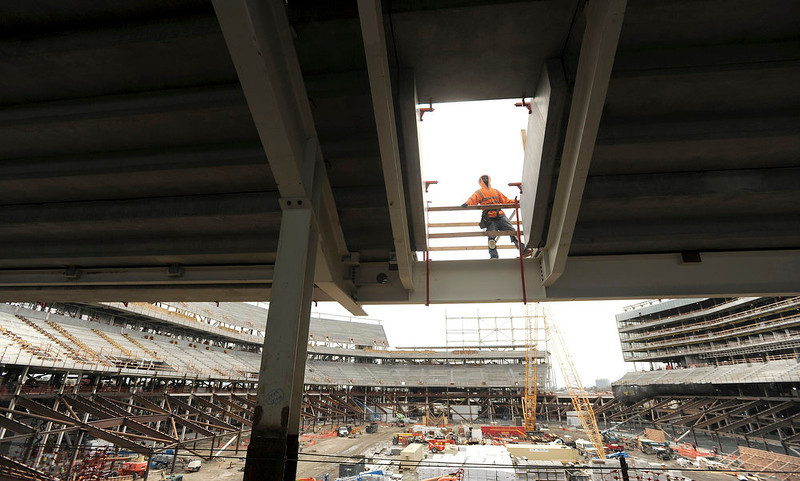 . A worker passes an opening at Santa Clara Stadium, the future home of the NFL\'s San Francisco 49\'ers, in Santa Clara, California  March 6, 2013. The stadium is scheduled to open in time for the 2014 NFL season.  REUTERS/Noah Berger