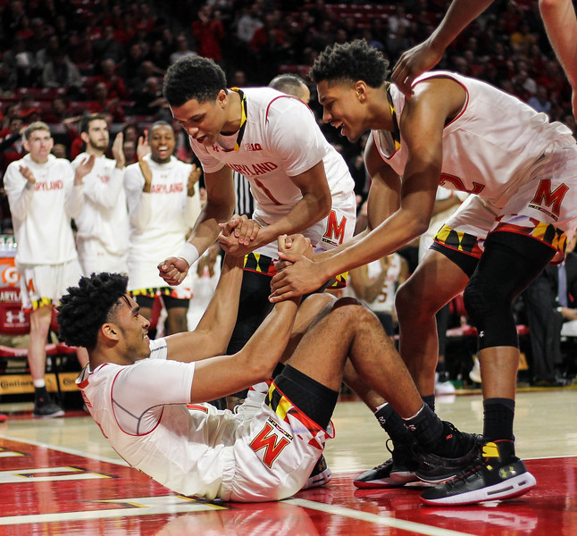 January 14, 2019: Maryland players embrace forward Ricky Lindo Jr (14) after taking a charge during BIG Ten Men Basketball action between University of Wisconsin and University of Maryland in College Park. Photo by: Chris Thompkins/Prince Georges Sentinel