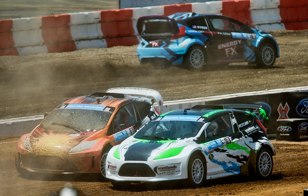 . Drivers Harry Cheung (#88), left, and Alexander Westlund (#55) compete in the Ford RallyCross Lites final round during X Games Los Angeles at Irwindale Event Center on Sunday, August 4, 2013. Joni Wiman (#93) won gold.  (SGVN/Staff photo by Watchara Phomicinda)