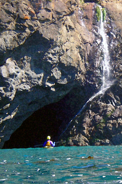 Charles heading into a cave under the waterfall.