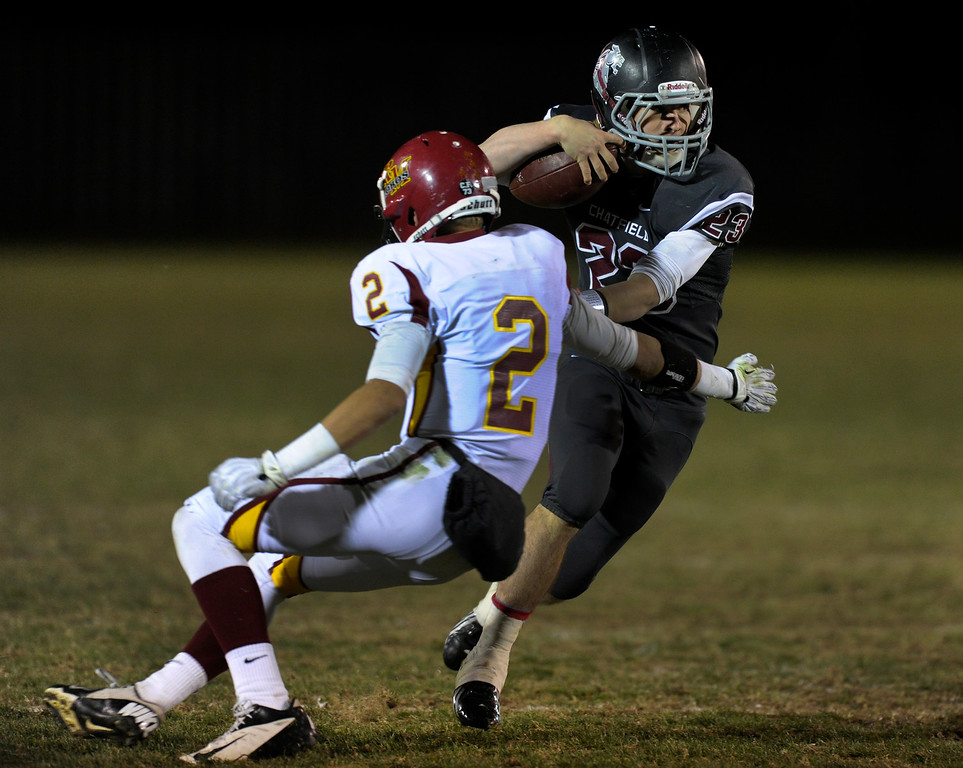 . Chatfield running back Michael Callahan-Harris (23) made a move past Lobos safety Marc Bachman (2) in the second half.  Photo By Karl Gehring/The Denver Post