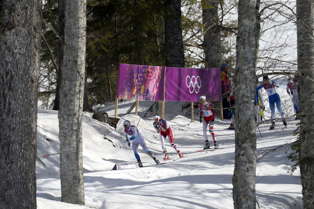 . Sweden\'s Charlotte Kalla (L) Norway\'s Heidi Weng and Norway\'s Kristin Stoermer Steira compete at the start of the Women\'s Cross-Country Skiing 30km Mass Start Free at the Laura Cross-Country Ski and Biathlon Center during the Sochi Winter Olympics on February 22, 2014, in Rosa Khutor, near Sochi.  (PIERRE-PHILIPPE MARCOU/AFP/Getty Images)