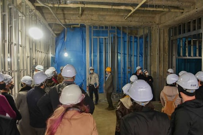Subject team leaders tour the campus to become familiar with the interior layout and their eventual work areas.