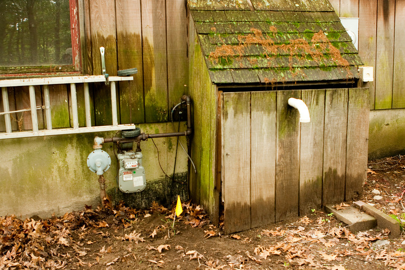 Apparently at one point this tiny shed contained an external furnace unit.  Now it just has the exhaust from the condensing furnace.  Note the fiber and yellow digsafe flag (natural gas).