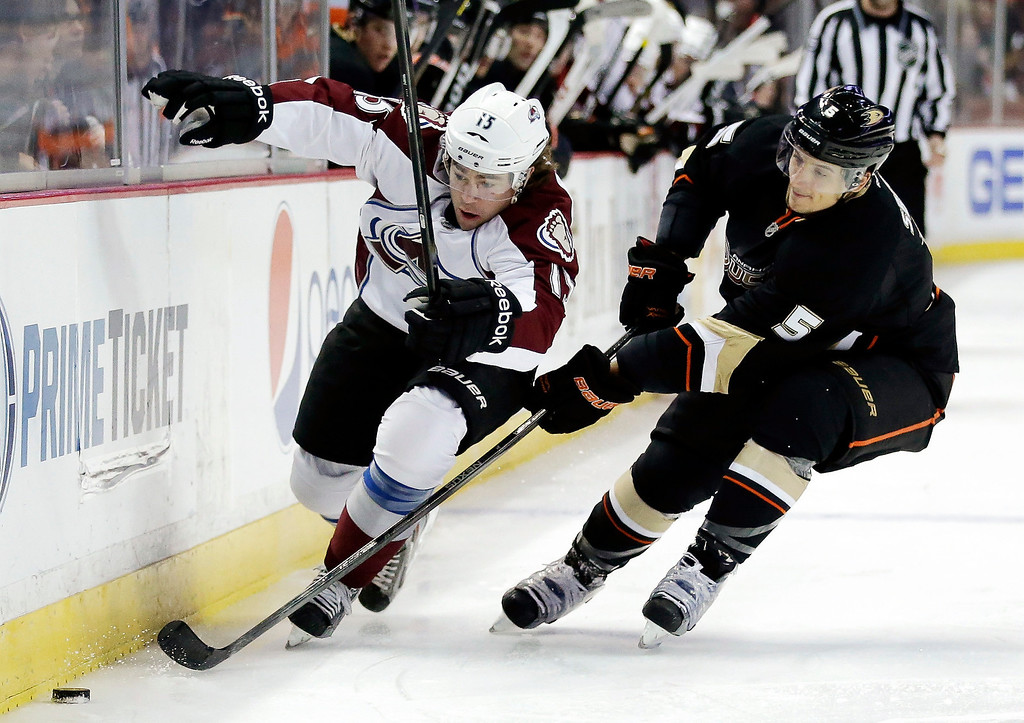 . Anaheim Ducks right wing Kyle Palmieri, right, battles Colorado Avalanche right wing P.A. Parenteau for the puck during the first period of an NHL hockey game in Anaheim, Calif., Sunday, Feb. 24, 2013. (AP Photo/Chris Carlson)