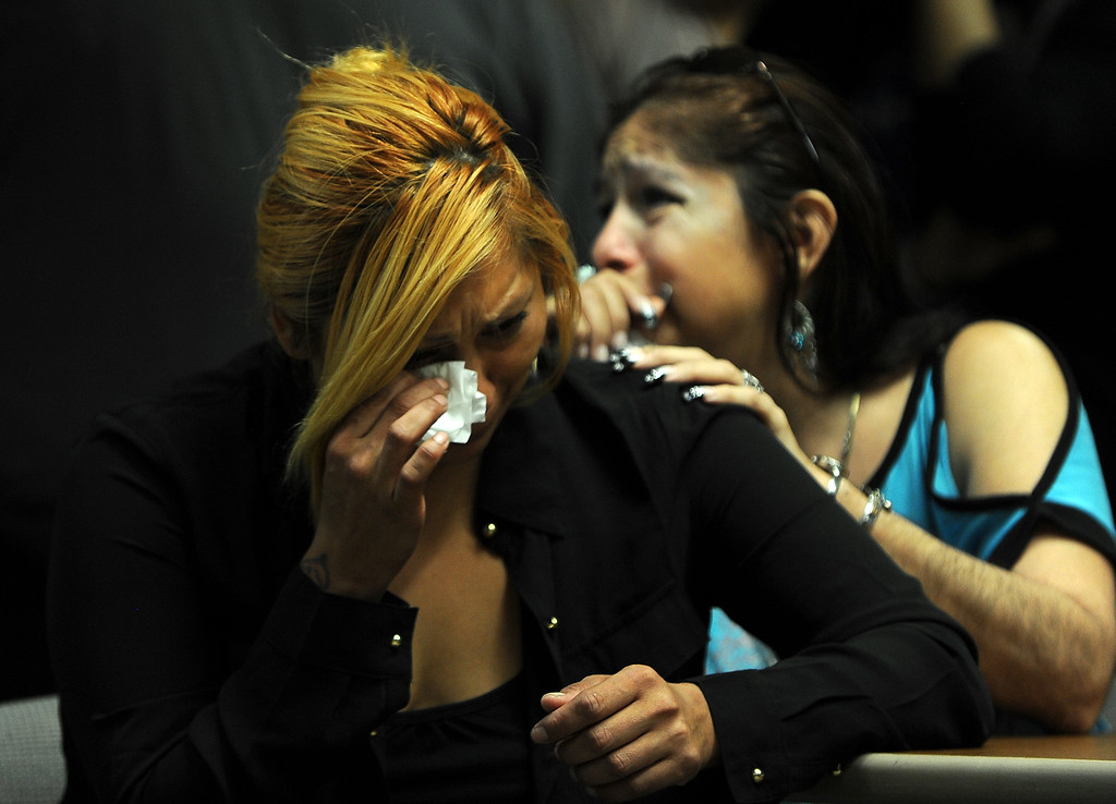 . Janet Cruz,left and Rosie Curonilla, mother of Daniel Olivera breaks down after watching a surveillance footage of her son death during a press conference at the San Bernardino County Sheriff\'s Head quarters Thursday August 22, 2013 in San Bernardino. Daniel Olivera 26, of Hesperia was shot and killed at the AM/PM Arco convenience store on August 11, 2013 in Victorville.LaFonzo Carter/Staff Photographer