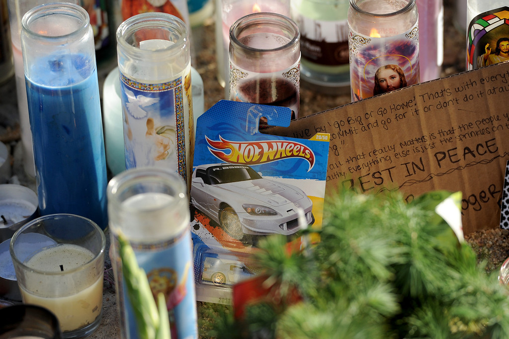 . Candles and a Hot Wheels car at the memorial for Paul Walker and Roger Rodas, Sunday, December 1, 2013, at the scene of their fatal crash site in Valencia. (Photo by Michael Owen Baker/L.A. Daily News)