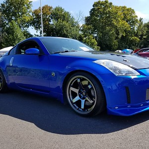 Charlie's 350Z on 19x9.5/10.5 Rota Grids (5x114.3/e15F/e15R/73) with custom Black Chrome powder coat finish.