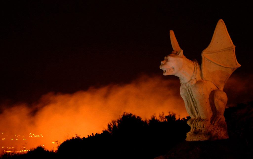 . A gargoyle statue remains untouched by the  Silver Fire near Banning, California August 7, 2013.  Hundreds of residents of three small communities in the high desert east of Los Angeles were evacuated on Wednesday as an out-of-control wildfire headed toward them.    Photo by Gene Blevins/LA Daily News