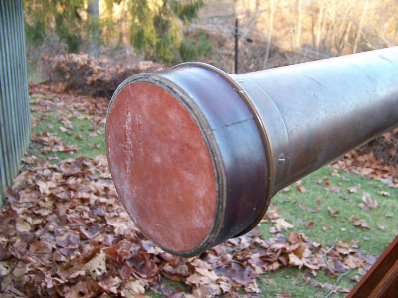 Leather lens cap may not be original to this telescope.