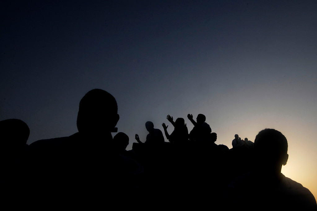 . Muslim pilgrims prays at sunrise on a rocky hill called the Mountain of Mercy, near the holy city of Mecca, Saudi Arabia, Monday, Oct. 14, 2013. Countless Muslims have continued that same journey as part of an elaborate and physically demanding set of purification rites known as hajj. Muslims believe the rituals, which start in Mecca and culminate in Mount Arafat, also trace the footsteps of the prophets Abraham and Ishmael.(AP Photo/Amr Nabil)