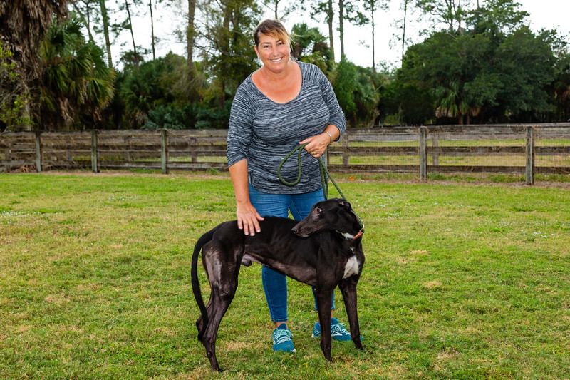 Sonia Stratemannn and one of the greyhounds rescued from the Canidrome in Macau China on Wednesday, January 23, 2019 at Elite Greyhound Adoptions in Loxahatchee, Florida. Elite Greyhound Adoptions in Loxahatchee Groves has been rescuing greyhounds from the infamous Canidrome, in Macau, China.  The Canidrome closed in July 2018 and over 600 dogs are being shipped to rescues in Europe and America. The dogs are crated in Macau, transported to the airport in Hong Kong, flown to Frankfurt, Germany, transferred to another plane and then flown to Miami International Airport, where they pass through customs and eventually get picked up by Stratemann to start their new lives.  [JOSEPH FORZANO/palmbeachpost.com]