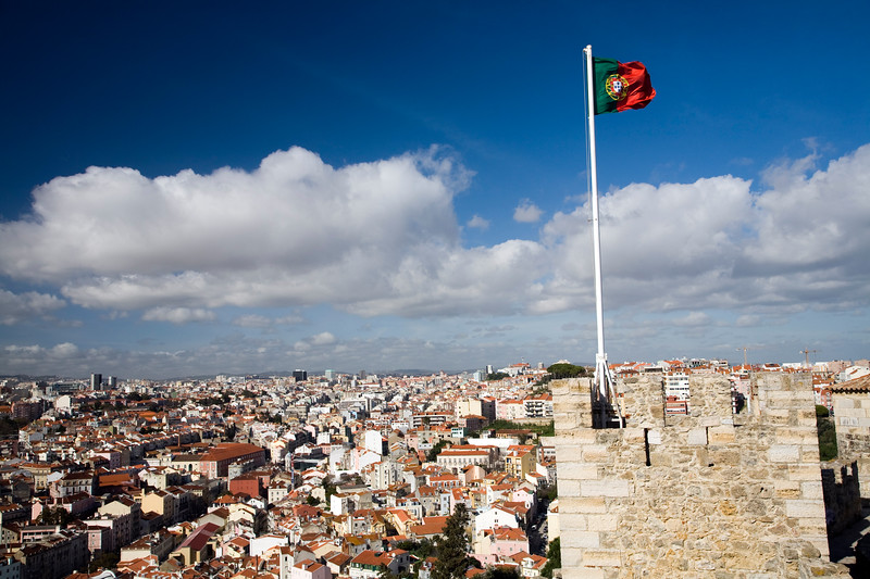 The Portuguese flag fluttering over Lisbon on Saint George castle