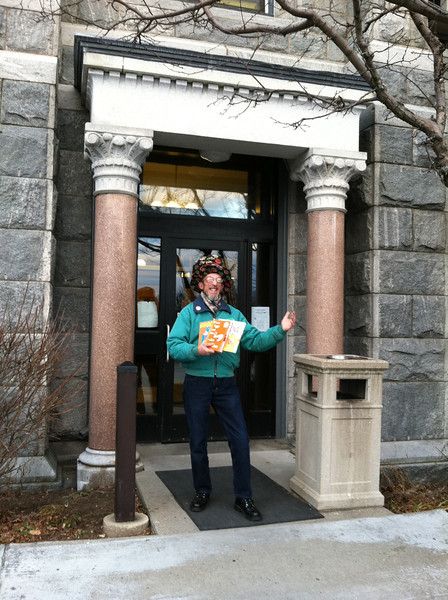 """Children's story reader """"Mr. Tim"""" at the entrance nearest the parking lots.  An elevator is inside, on the right."""