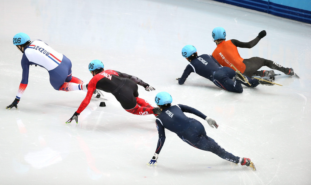 . Dutch Sjinkie Knegt (R) and Park Se Yeong of Korea collide in the men\'s 1500m B final of the Short Track competitions in the Iceberg Skating Palace at the Sochi 2014 Olympic Games, Sochi, Russia, 10 February 2014.  EPA/HOW HWEE YOUNG