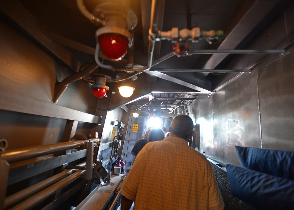 . People take a tour of the USS Spruance, an Arleigh Burke-class guided missile destroyer, which is docked in the Port of Los Angeles for Navy Days.  One of the passage ways. Saturday, August 09, 2014, San Pedro, CA.   Photo by Steve McCrank/Daily Breeze