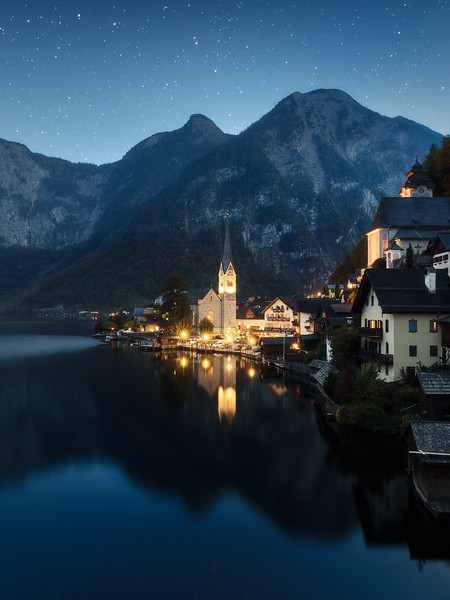 Hallstatt night blue hour stars Austria alps town cropped.jpg