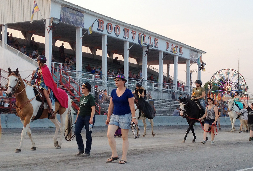 . 4-H members and their horses take part in the annual parade at the Boonville Oneida County Fair on Tuesday, July 22, 2014 in Boonville. the fair runs through Sunday, July 27, 2014.  JOHN HAEGER-ONEIDA DAILY DISPATCH @ONEIDAPHOTO ON TWITTER