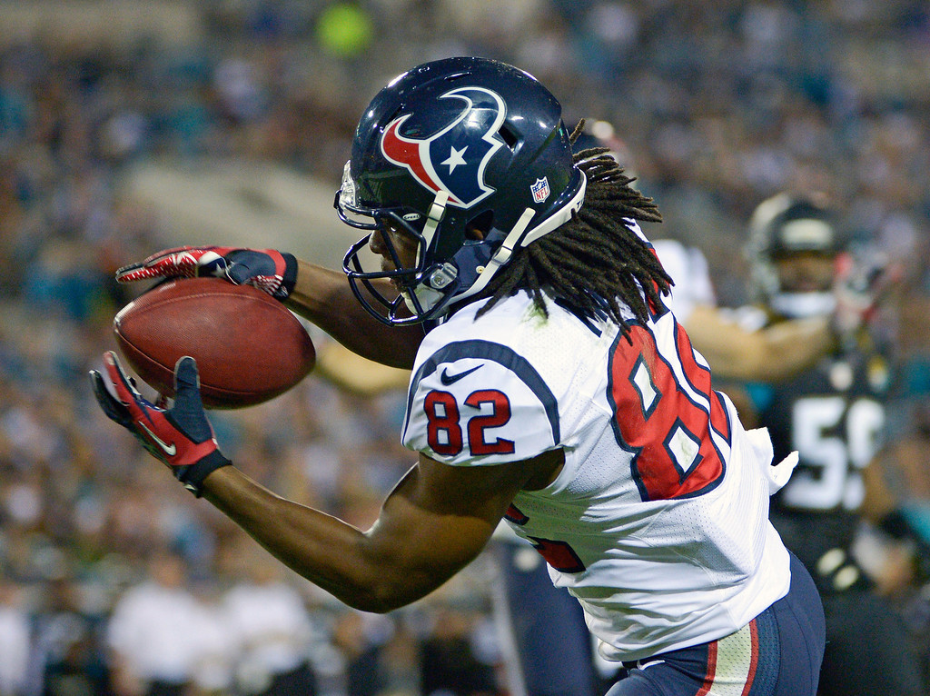. Houston Texans wide receiver Keshawn Martin catches an 8-yard pass for a touchdown against the Jacksonville Jaguars during the first half of an NFL football game in Jacksonville, Fla., Thursday, Dec. 5, 2013.(AP Photo/Phelan M. Ebenhack)
