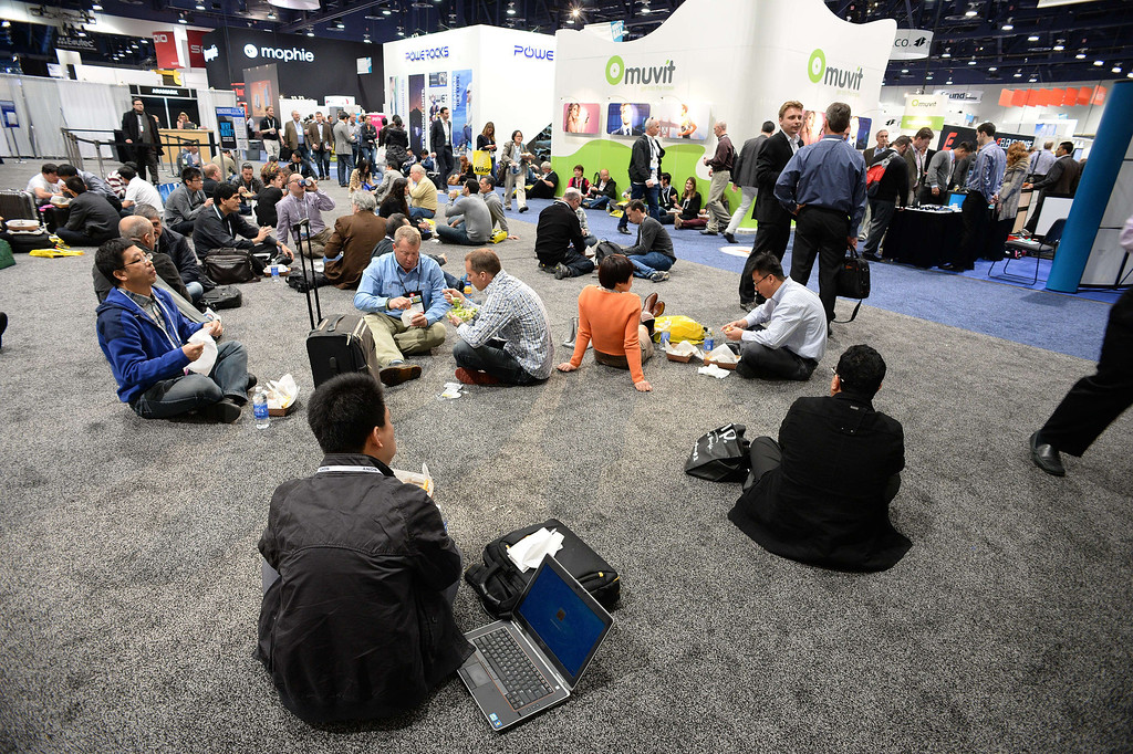. Attendees sit on the floor of the North Hall of the Las Vegas Convention Center as they eat lunch during the 2014 International CES in Las Vegas, Nevada, January 8, 2014.   AFP PHOTO / ROBYN BECK/AFP/Getty Images