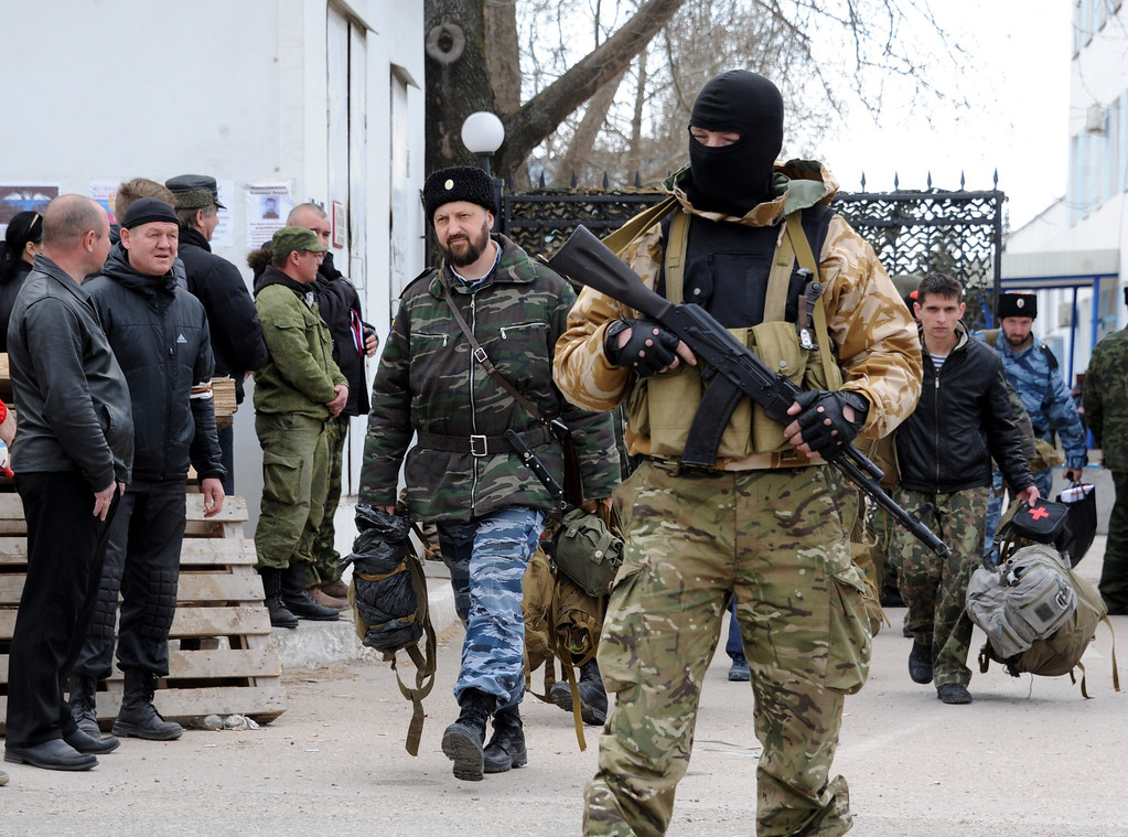 . Pro-Moscow militants carry bags out of the Ukrainian navy headquarters in Sevastopol after they seized it on March 19, 2014.  AFP PHOTO/  VIKTOR DRACHEV/AFP/Getty Images