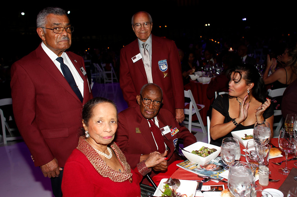 . (Seated at right) Edna Mosley and her husband, former Tuskegee Airman Lt. Col. John Mosley, at the Red Tails Gala to mark the 70th anniversary of the Tuskegee Airmen in Denver on Saturday, Nov. 19, 2011. (David Zalubowski, Special to The Denver Post)